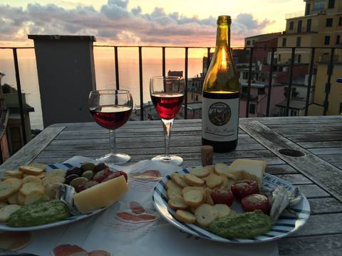 Image Title: October Sunset Dinner on the Rooftop Terrace in Riomaggiore. [Photo: Open Door Travelers]