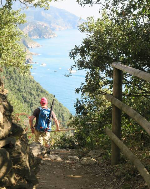 Image Title: On the Trail, Vernazza can be seen in the distance.. [Photo: Open Door Travelers]