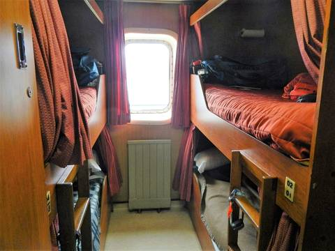 Image Title: 4 Person Cabin on a Navimag Ferry.  [Photo: Open Door Travelers]