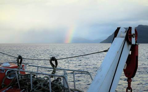 Image Title: Rainbow over the Patagonian Fjords.  [Photo: Open Door Travelers]