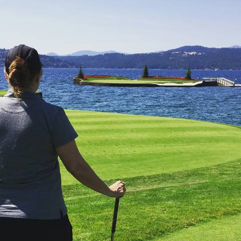 Image Title: The iconic 14th Floating Green at the Coeur d'Alene Resort. [Photo: Open Door Travelers]