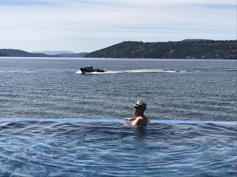 Image Title: The Infinity Pool overlooking the Lake at the Coeur d'Alene Resort. [Photo: Open Door Travelers]