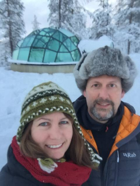 Image Title: Arctic Selfie in front of our Glass Igloo [Photo: Open Door Travelers]