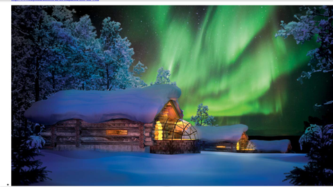 Image Title: The Northern Lights display over a cabin {Photo: www.kakslauttanen.fi]