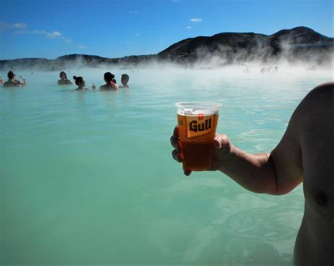 Image Title: Enjoying a Beer at the Blue Lagoon. [Photo: Open Door Travelers]