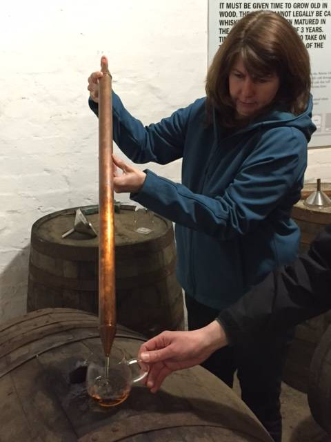 Image Title: Pulling our own dram from the Cask [Photo: Open Door Travelers]